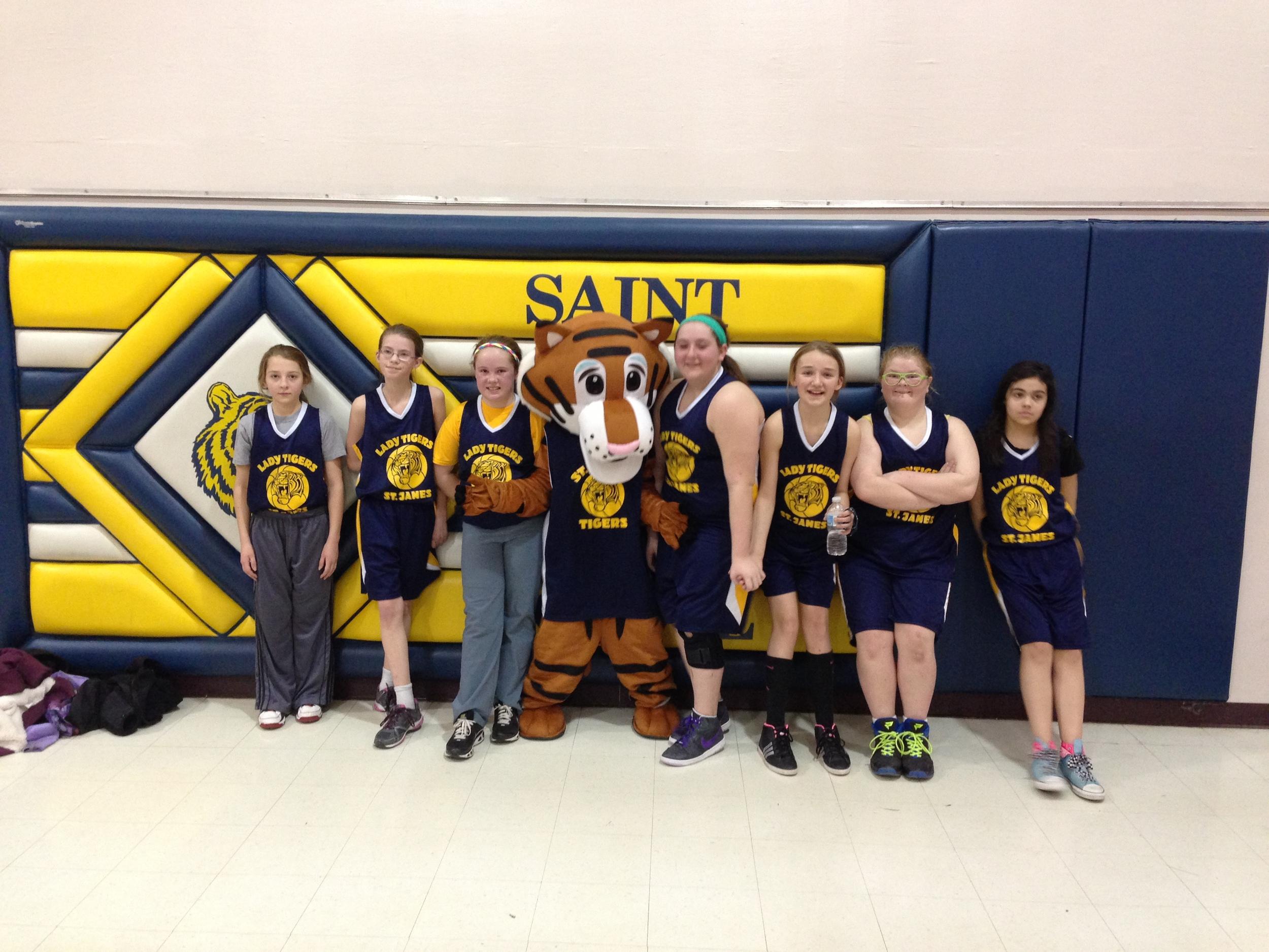 6th Grade girls basketball team with Thunder