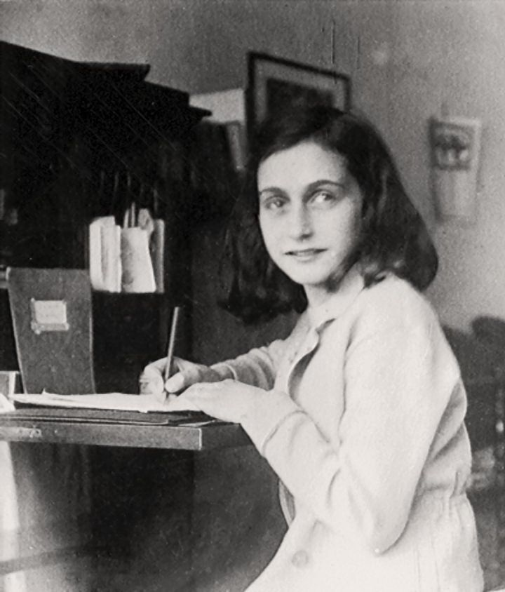 Anne Frank at her writing desk