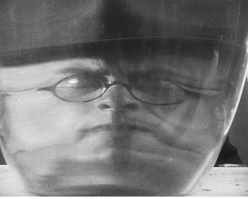 "Sergei Komarov as Chiche, the evil capitalist, as seen inside his ""death lab"""