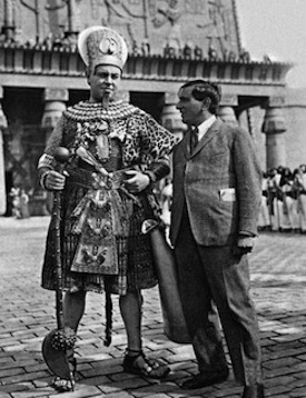 Emil Jannings, in costume as Amenes, Pharaoh of Egypt, and director Ernst Lubitsch on the set.