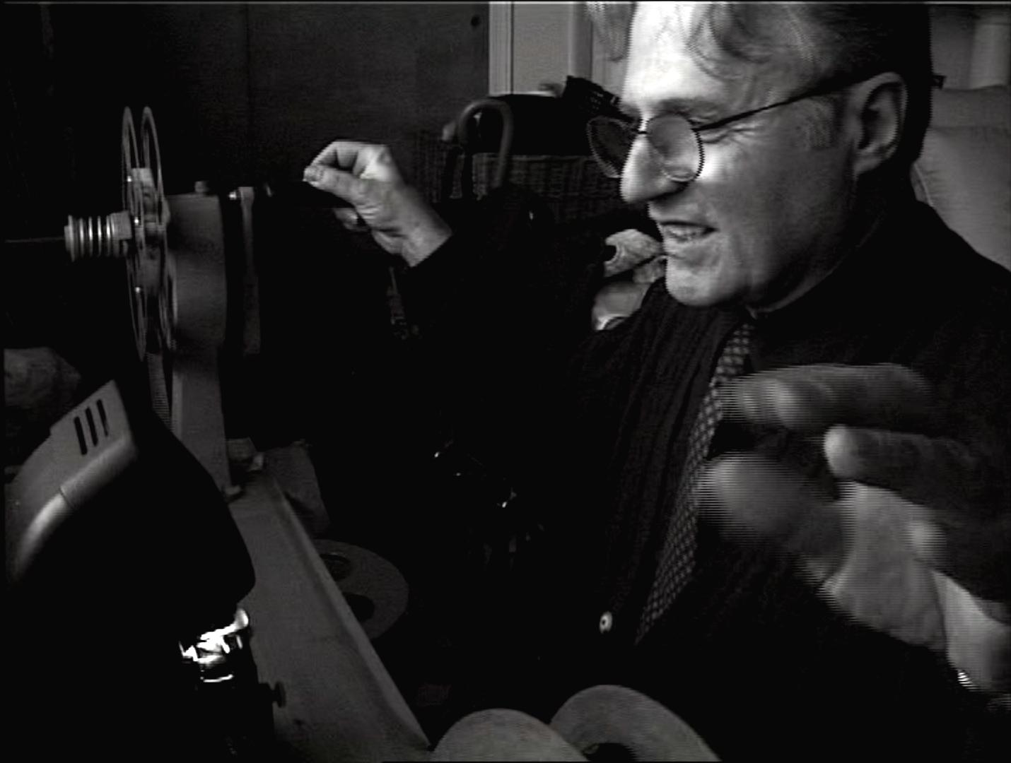 Artist Gerard Malanga viewing rare film from Marie Menken's Archive.