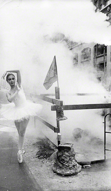"Diaz ""en pointe"" next to street construction with steam"