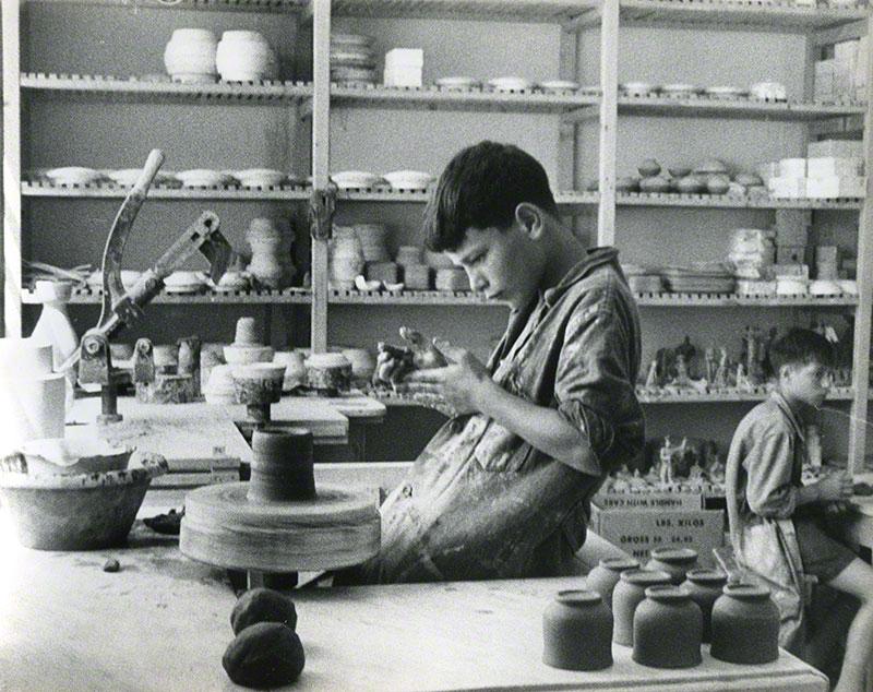 Two boys working in a ceramic studio