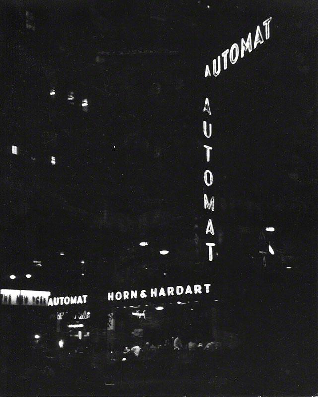 Nighttime view of Horn & Hardart Automat signs