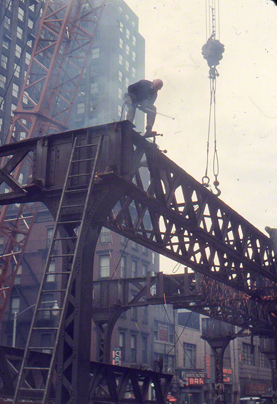 Welders dismantling iron beams