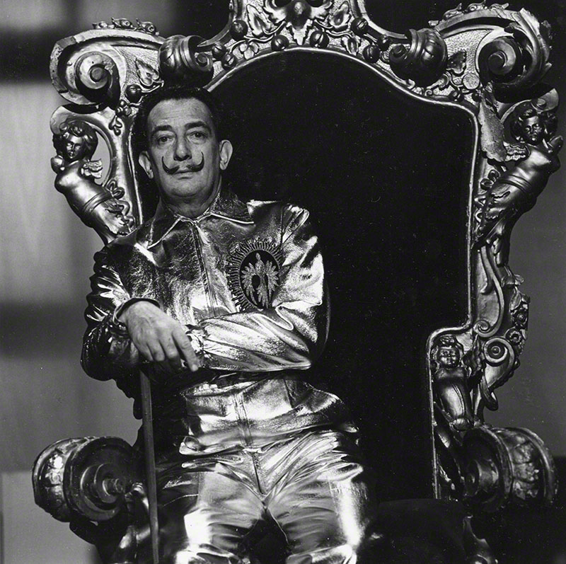 Salvador Dali seated on ornate throne chair