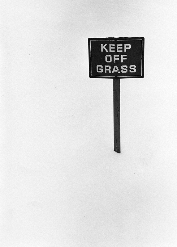 """""""Keep Off Grass"""" sign planted in a completely snow covered area"""
