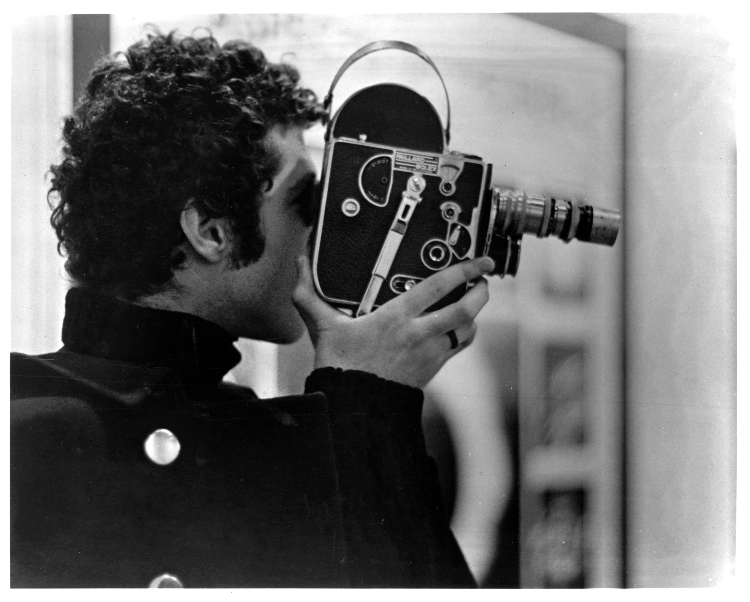Warren Sonbert with his Bolex camera.