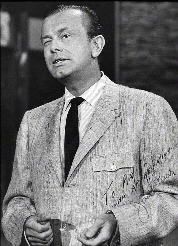 Inscribed close-up photo of Paar on set [during monologue].