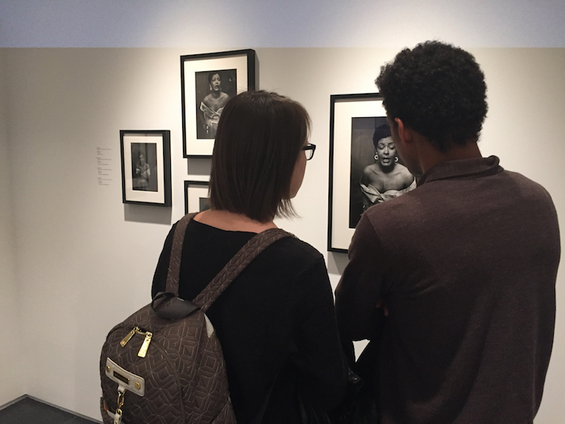 Guests of the public opening looking at the series of Billie Holiday photos from one of her last public appearances at Carnegie Hall, 1957. Photographs by Hugh Bell.
