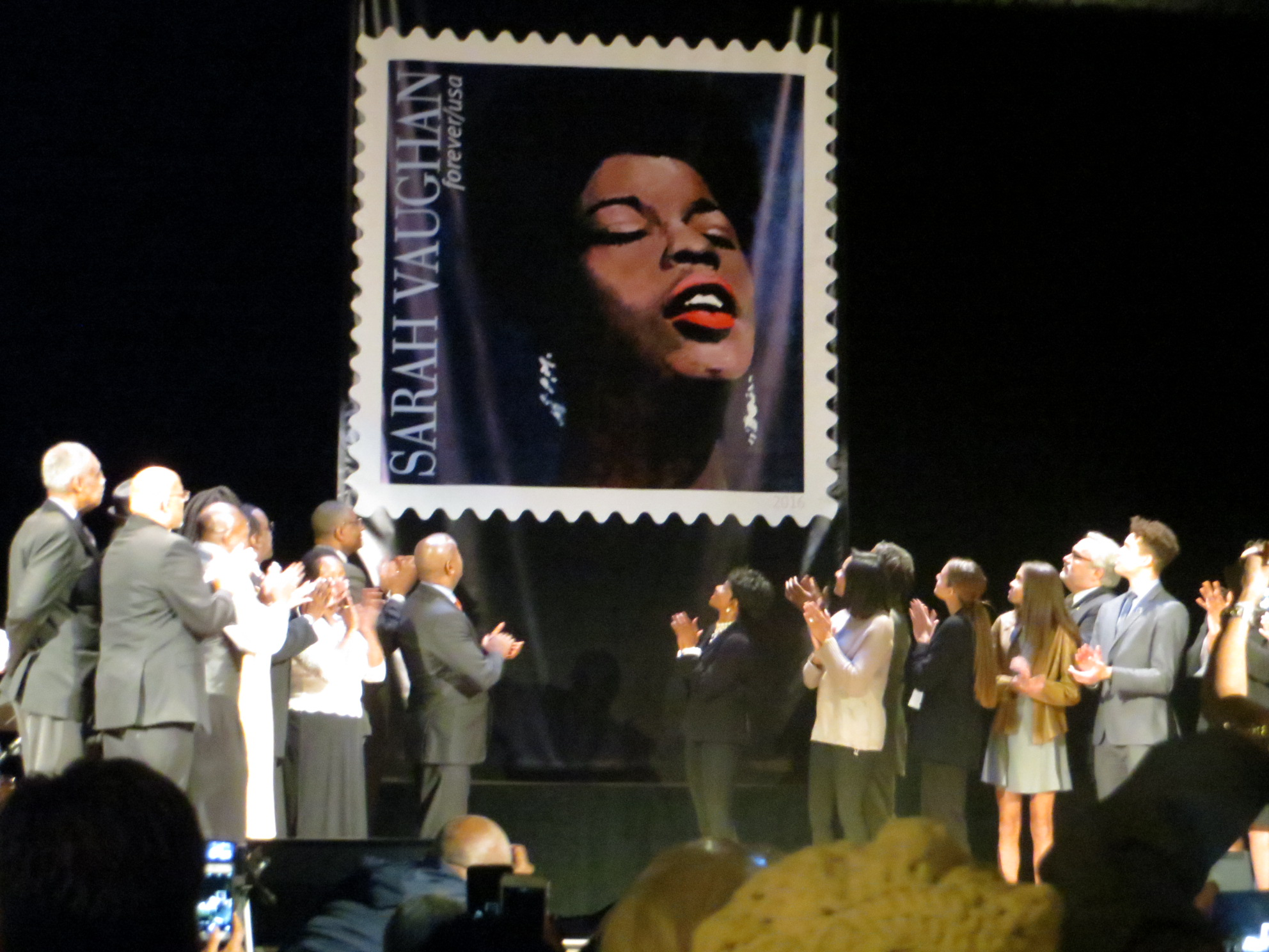 Special Guests of the event applaud at the unveiling of the Sarah Vaughan USPS Forever Stamp.