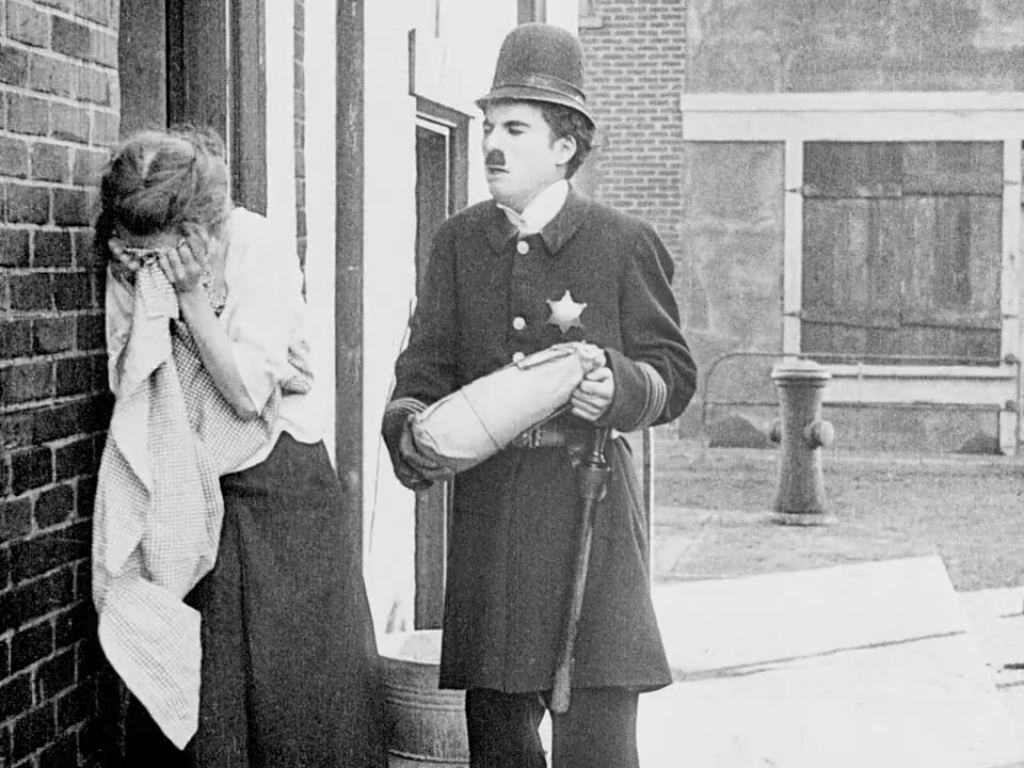 janet miller sully and charlie chaplin in  easy street  (1917)