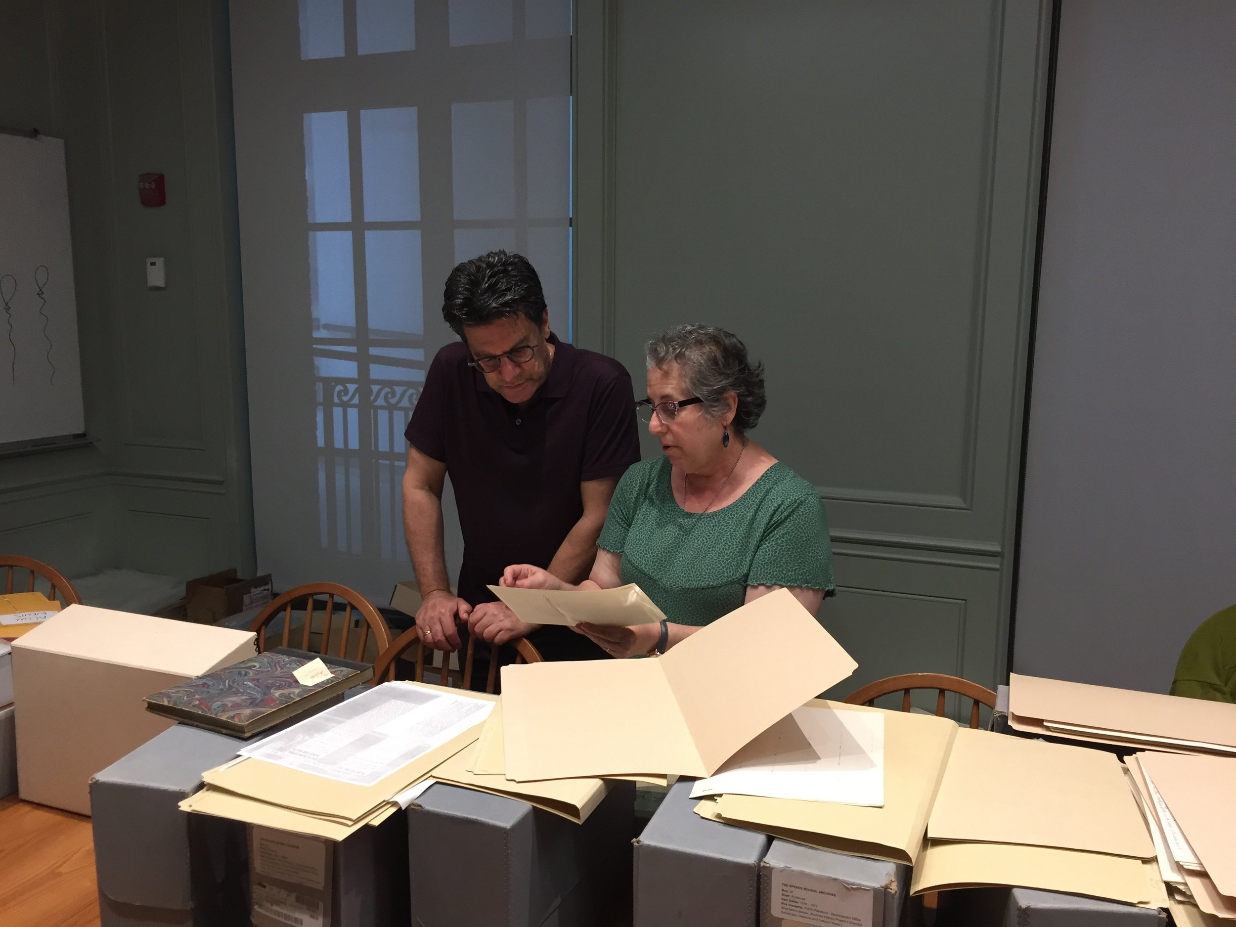 Curators David Deitch and Lisa Kaplan reviewing materials this summer (2019) in preparation for cataloguing and digitizing.