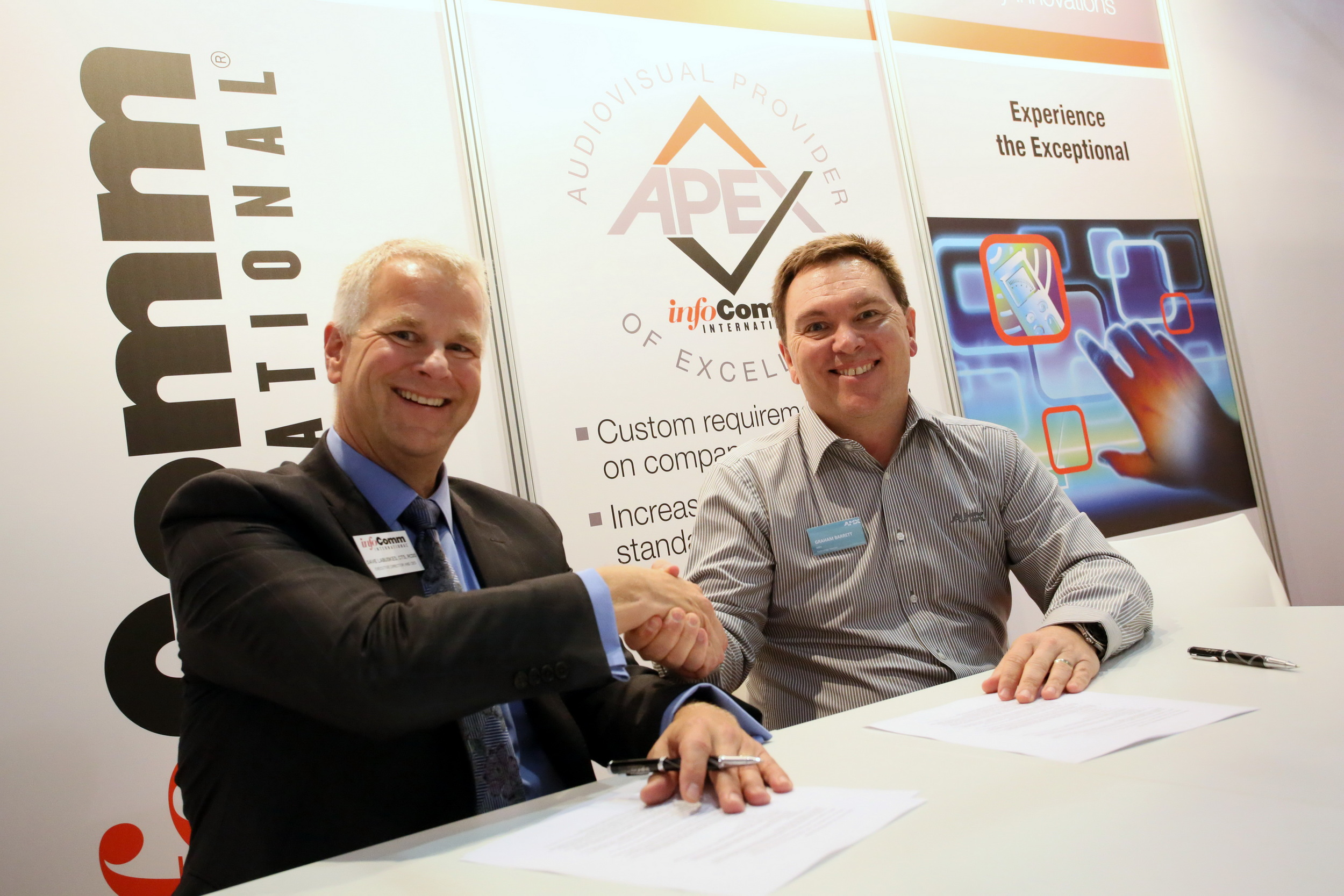 David Labuskes, InfoComm CEO and Graham Barrett, AMX Technology Director signing the NAVS agreement