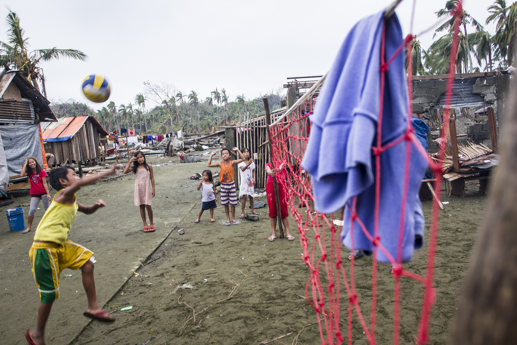 Boys playing volleyball in Legaspi, Samar. Because it was almost completely destroyed by Typhoon Haiyan, the school here will be closed for some time. In consequence, there is a holiday mood amongst the kids in spite of the wreckage everywhere.