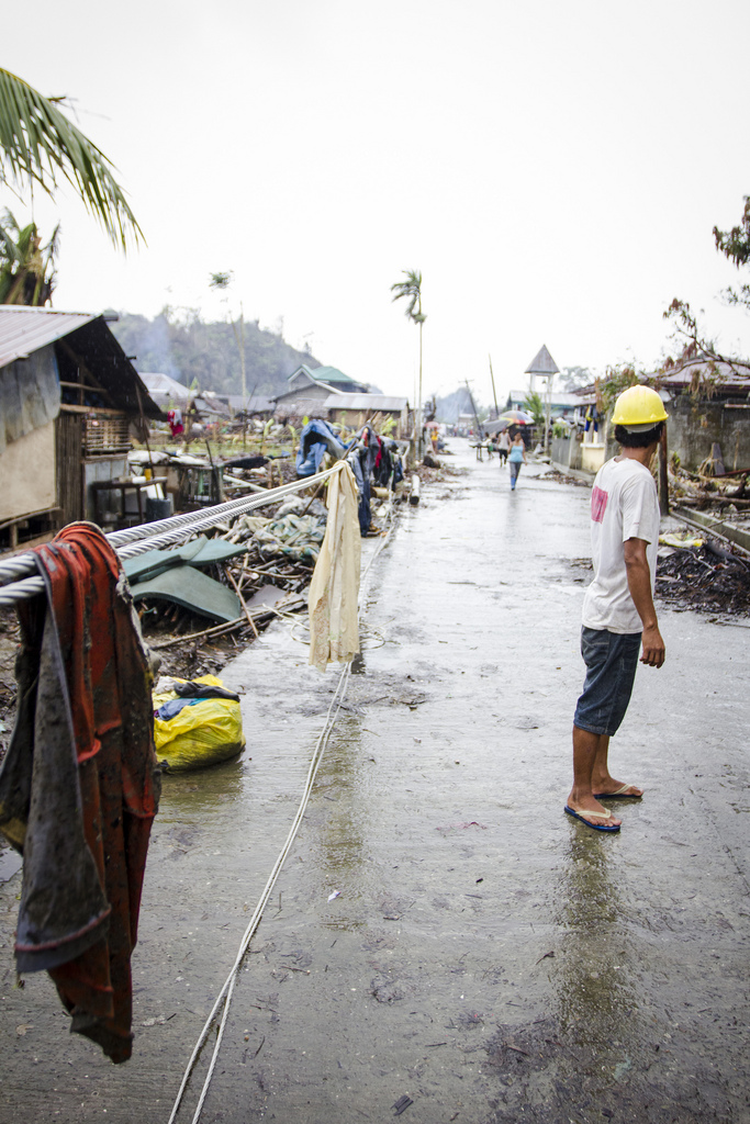 Power lines being used to dry washing on the main street of Veloso, Samar. It may be months before basic infrastructure is fully restored to parts of the Visayas region damaged by Typhoon Haiyan.