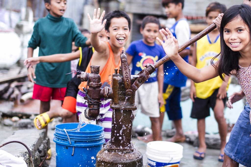 Kids pump water from a local well in Legaspi, Samar. The water from these wells has to be boiled before it can be drunk and it may be months before more clean water can be restored to areas like this in the wake of Typhoon Haiyan.