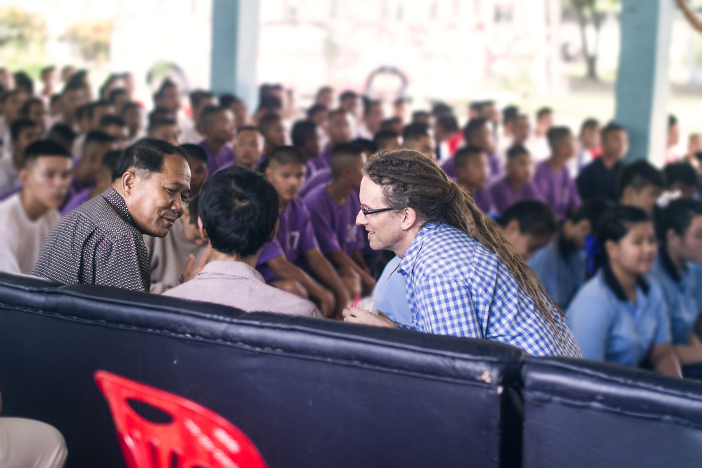Kenneth Fleck (far right) and Pii Daan (centre) chat with the director of the Mae Rim Juvenile Correction Facility before presenting to teenagers there about relationships, decision-making and the biology of HIV.