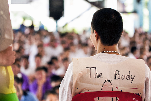 """""""The Body"""", played by a member of the audience at the Mae Rim Juvenile Correction Facility, faces his peers as the human immune system and HIV are explained in a sketch by members of Team Radical Grace. - photo by Chad Loftis"""