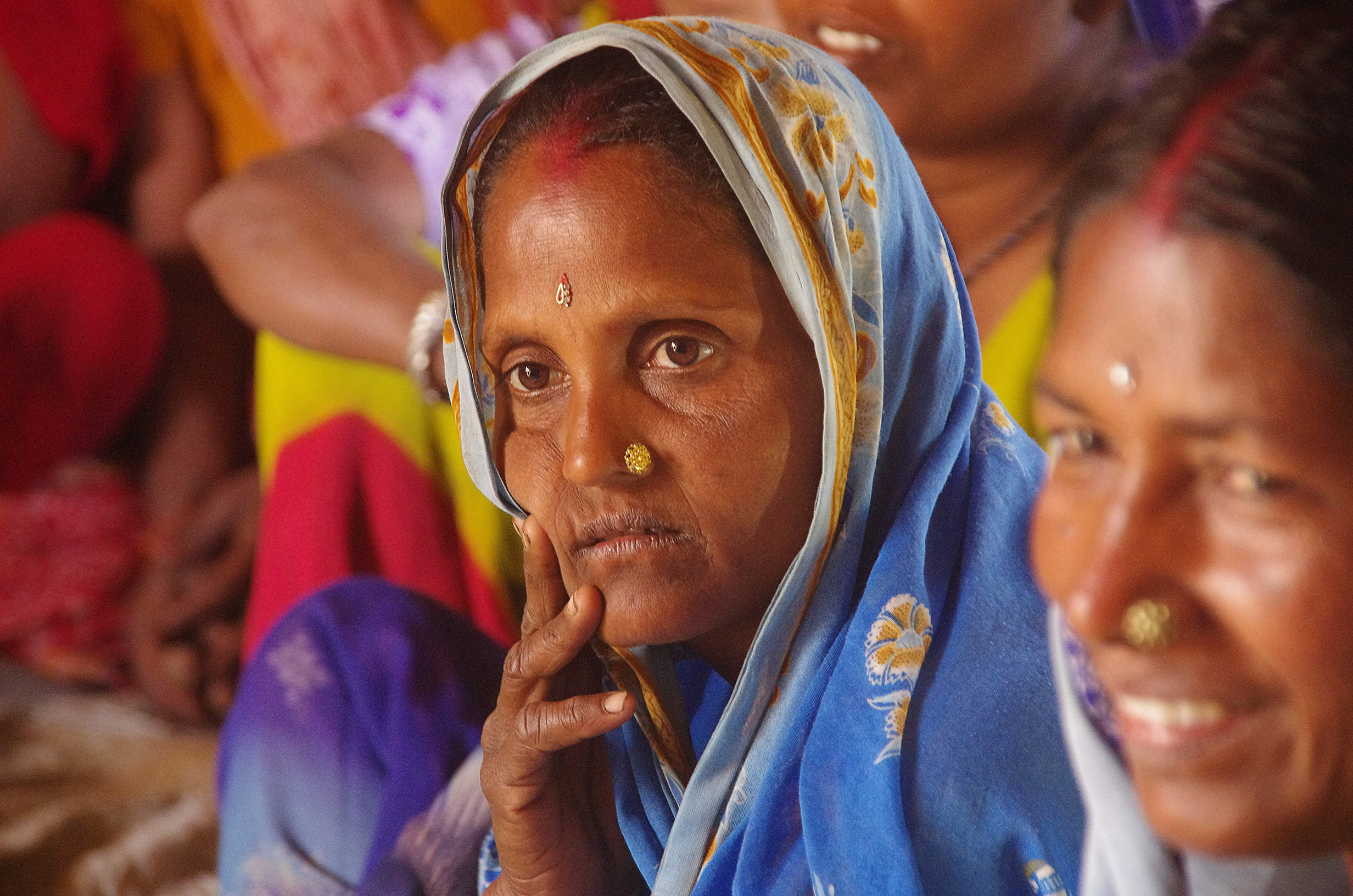 A woman listens during a CHETNA literacy class in India. CHETNA seeks to empower women of marginalised social groups throughout their lifecycle to give them more control over their own health and the health of their families and communities. - photo by Henry