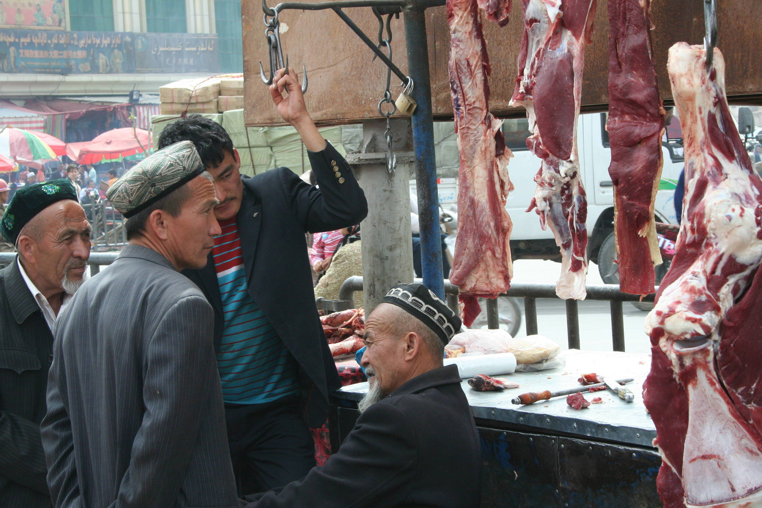Some Muslim minority men at a butcher in Western China. - Photo courtesy of  Kaj Iverson