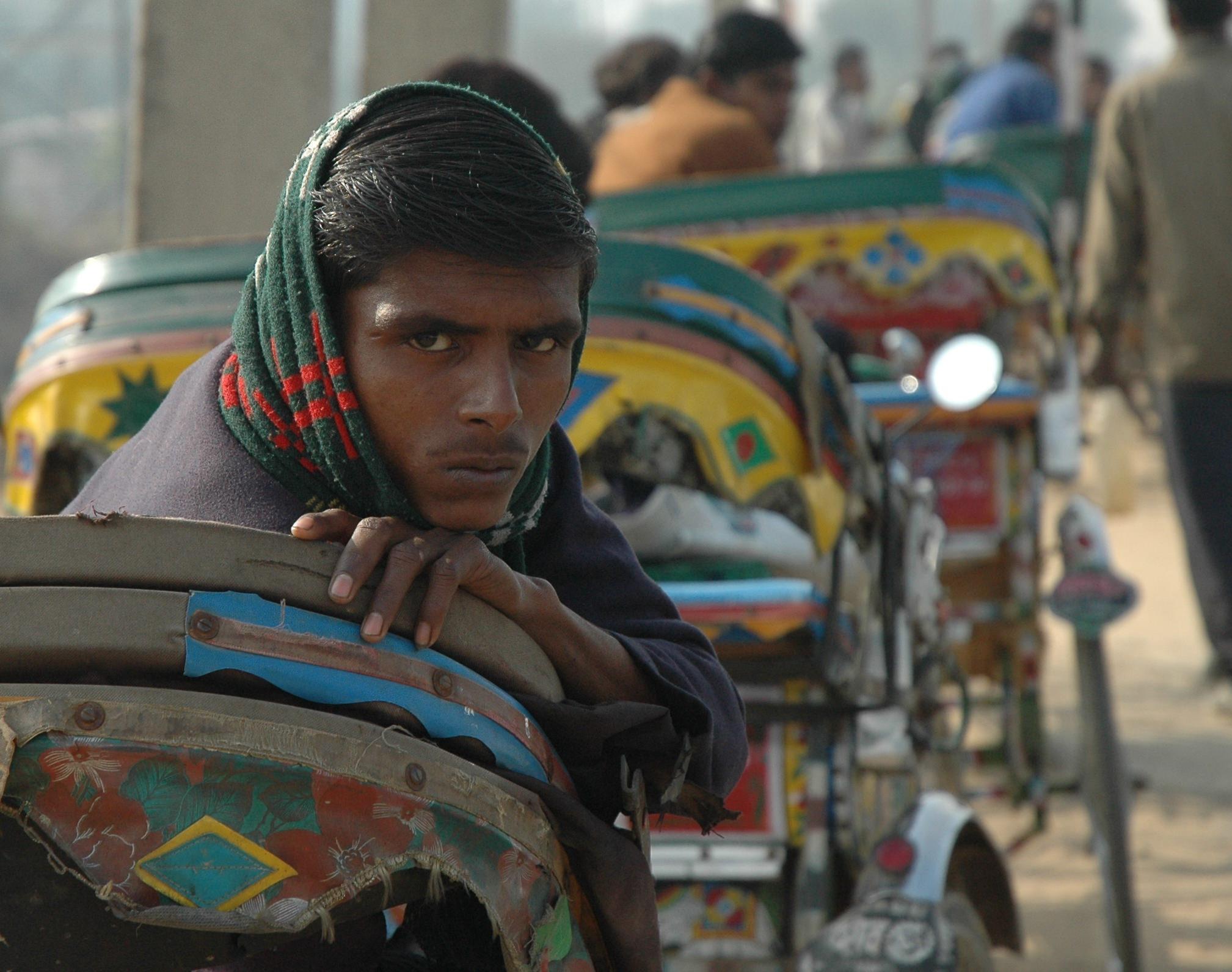 An Indian rickshaw driver waits for work. Photo courtesy of Pastalane.