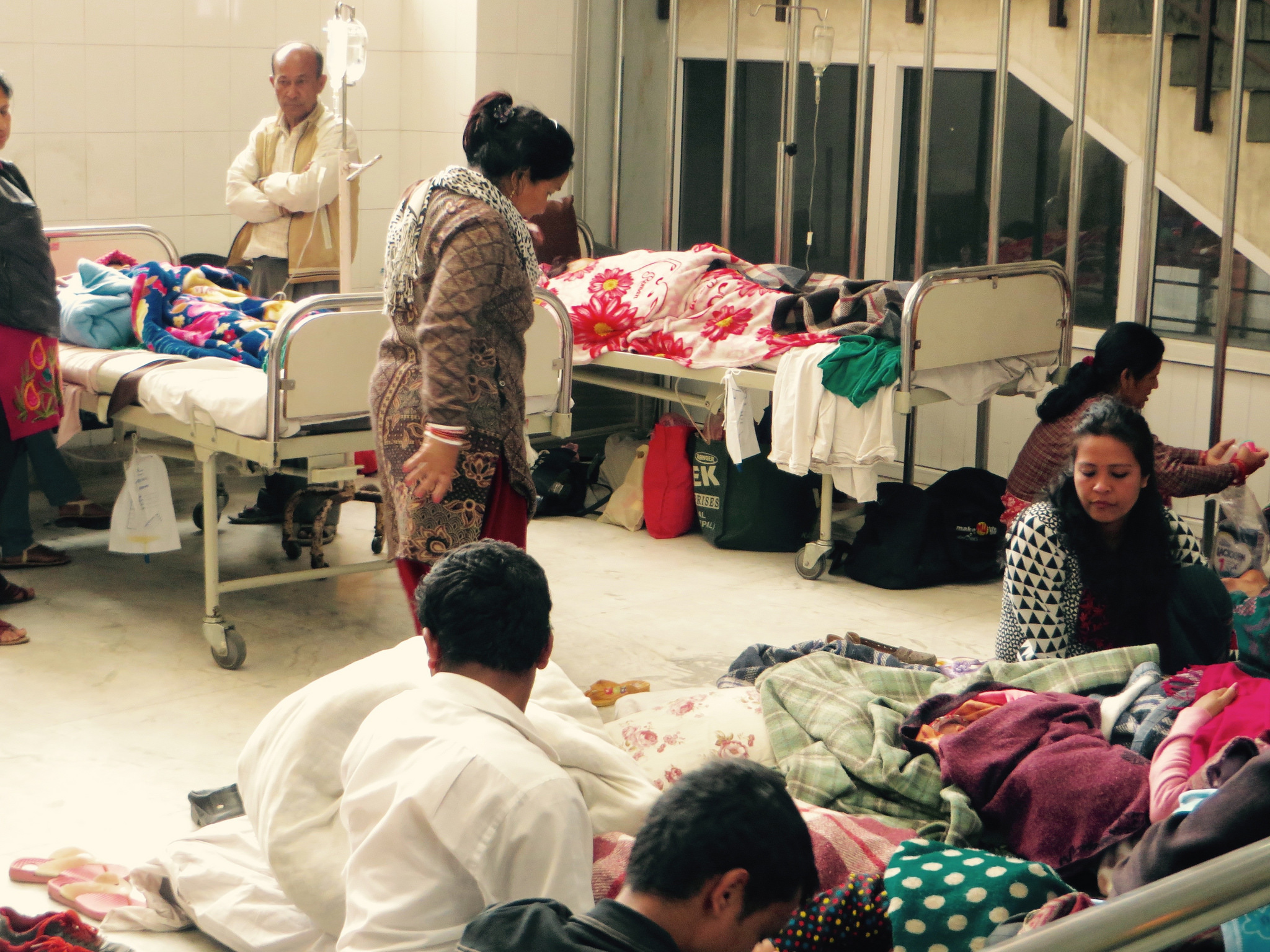 Many patients are being treated in hallways and lobbies at Kathmandu's Patan hospital. Photo by Gabriel Jens