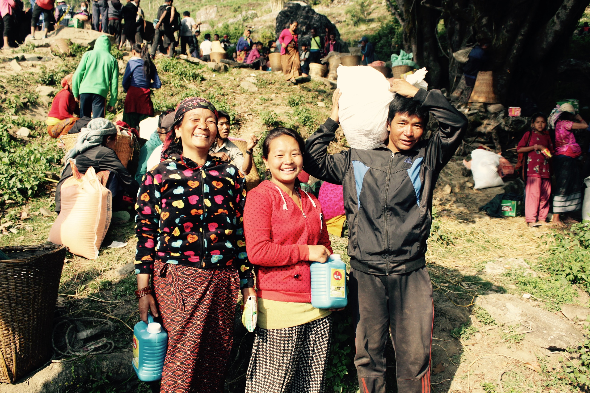 Residents of Chimchok in North Dhading happy to receive emergency supplies from the UMN relief convoy. Photo courtesy of UMN.