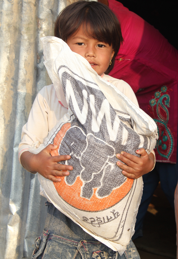 Granddaughter Supriya helps carry emergency supplies - Photo courtesy of UMN.