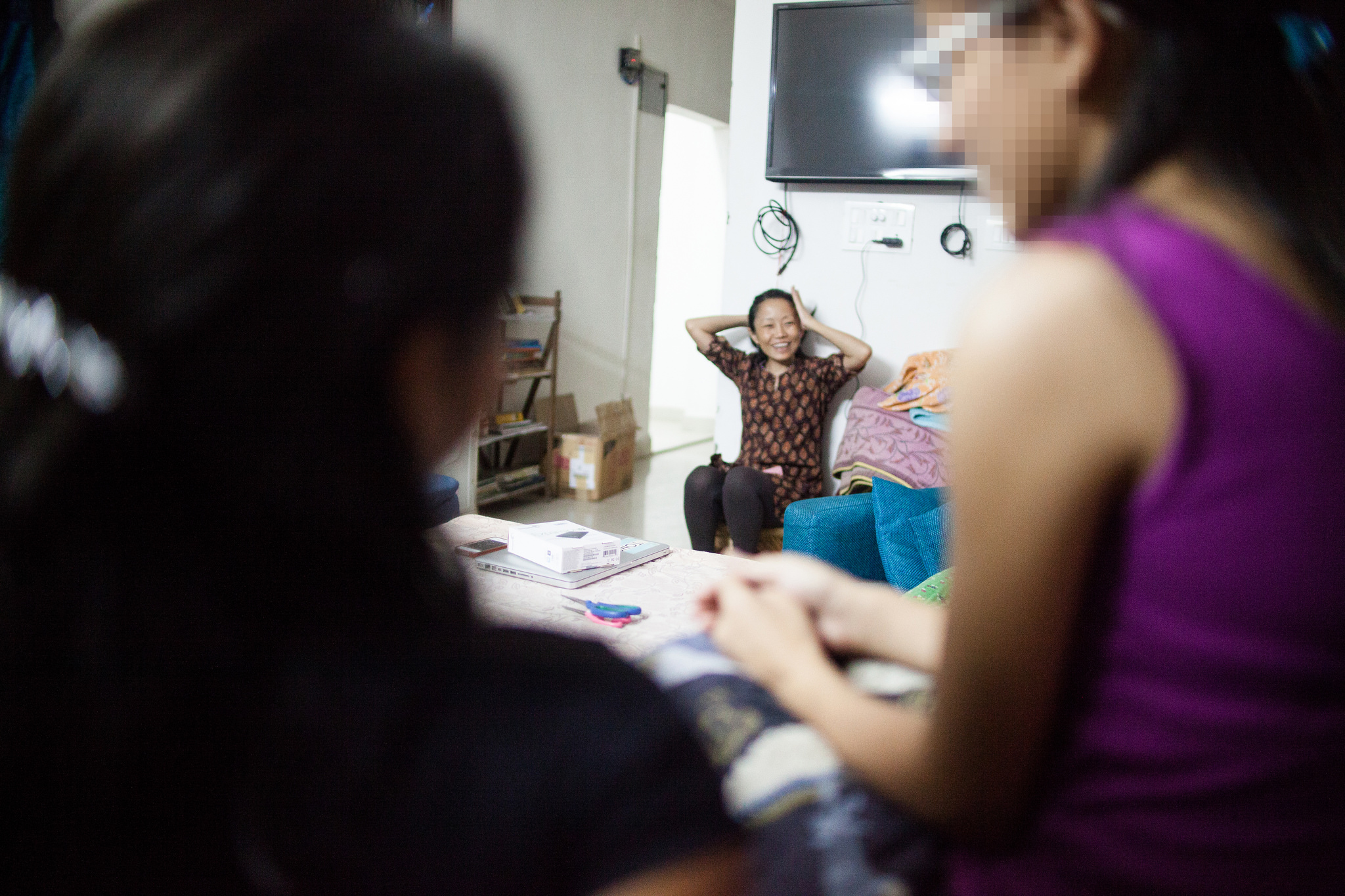 Irene shares a moment of laughter with the girls. The Beauty for Ashes staff hopes to add more caregivers to their team.