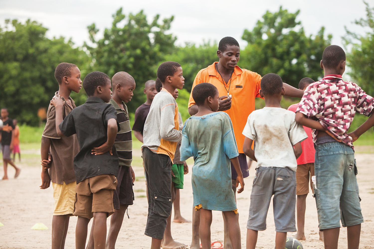 A Sports Friends coach training kids in Malawi. Besides South East Asia, where Coach Ben lives, Sports Friends operates in Africa and South America - photo by Erin Kranz