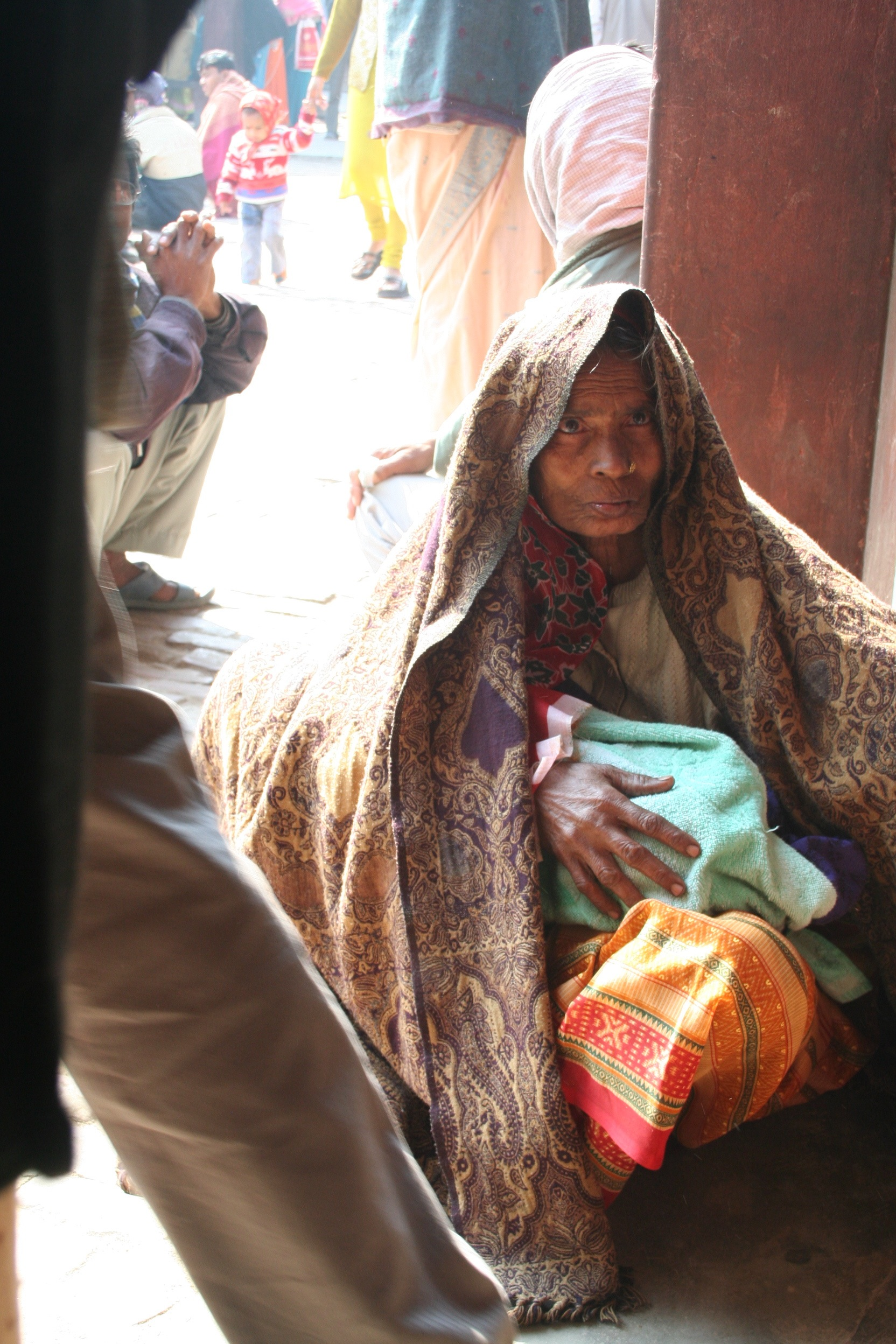A woman from the local community waits to see a doctor. Most women come to the hospital with a male relative, who often does all of the talking and makes all of the decisions on their behalf.- Photo by Brian