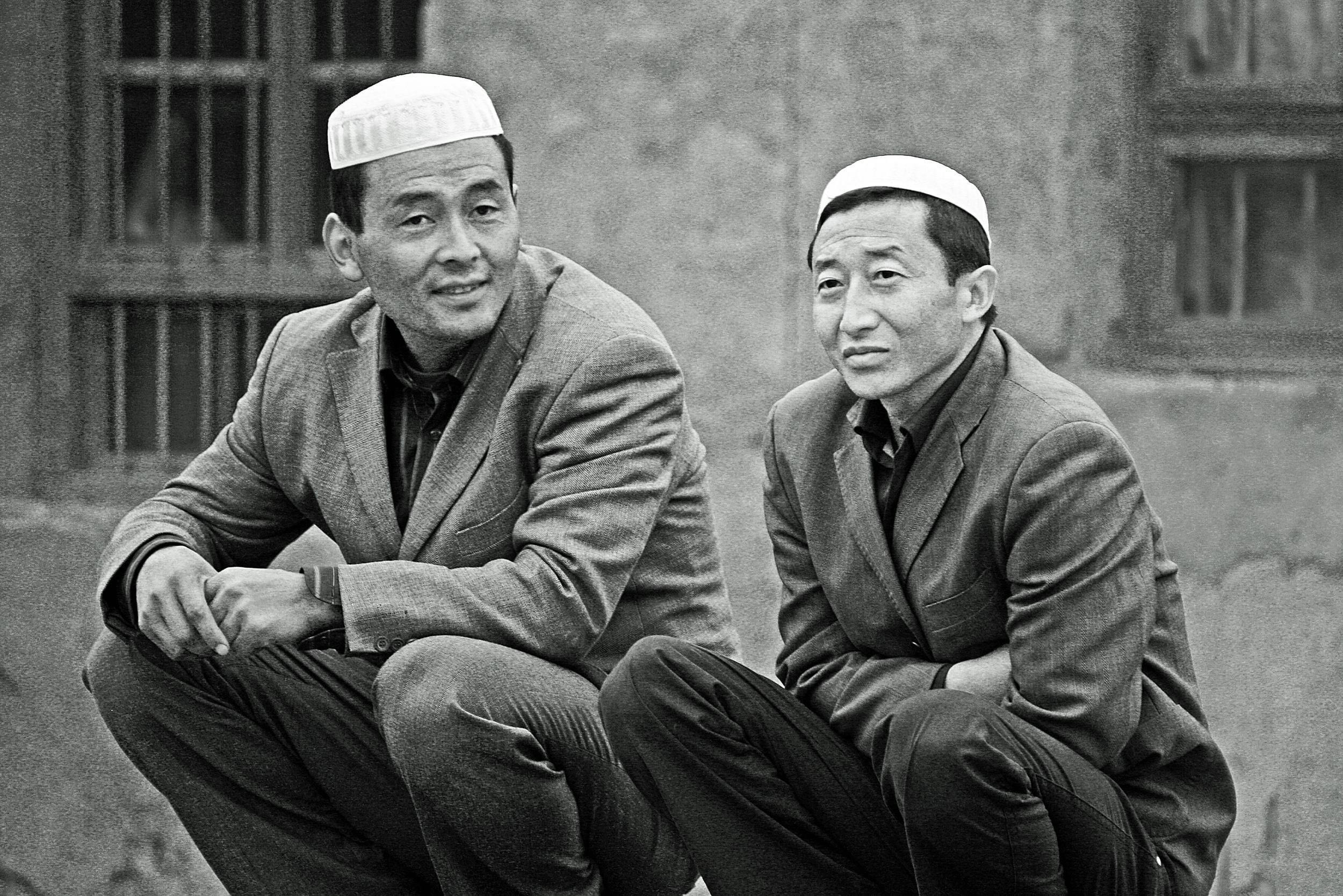 Two Hat men - Photo courtesy of  Tom Thai