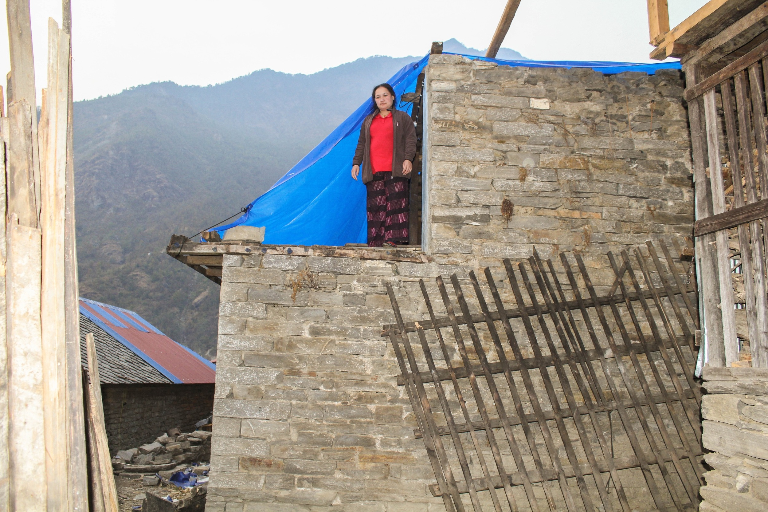 In the village of Tawal, also in Dhading district, many are still living in temporary shelters, or have made use of tarpaulin to cover exposed parts of their homes - Photo courtesy of Ramesh Man Maharjan.