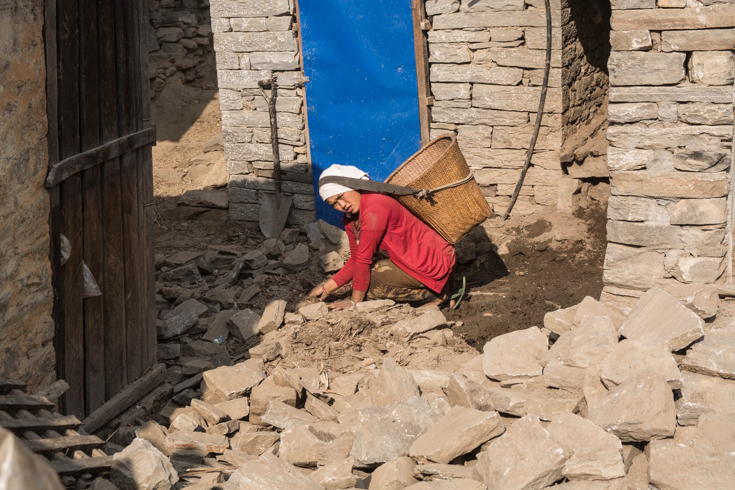 Many Nepalis who live in the rural, remote villages can neither afford nor have easy access to materials to reconstruct their homes. The best strategy is salvaging stone and wood from collapsed houses, but rebuilding them with more earthquake-resistant techniques - Photo by Mark Morrison.