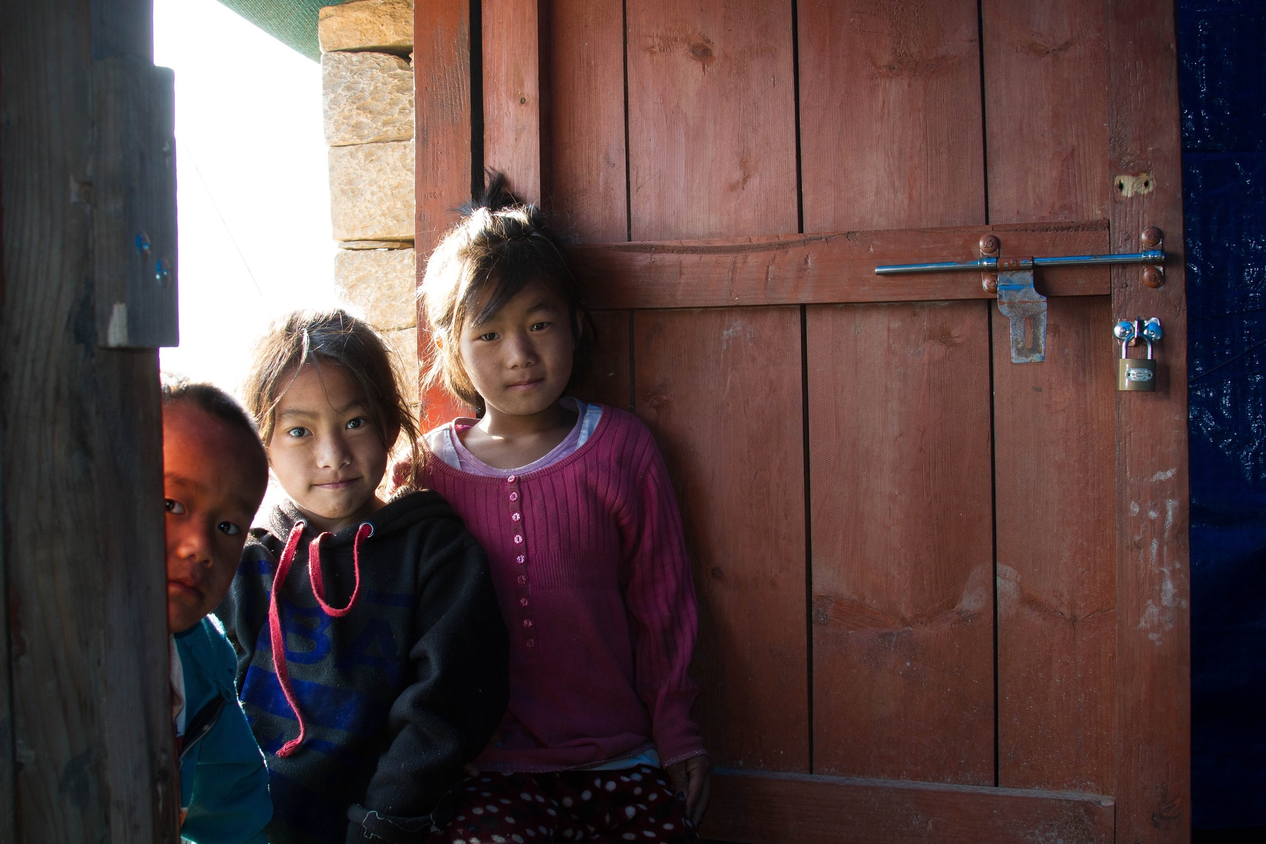 Children in Dhading have been able to return to school, as UMN has built 14 temporary learning centers throughout Dhading. UMN has begun to upgrade these temporary centers into semi-permanant ones, and also plans to build 45 permanent learning centers - Photo by Denise Poon.