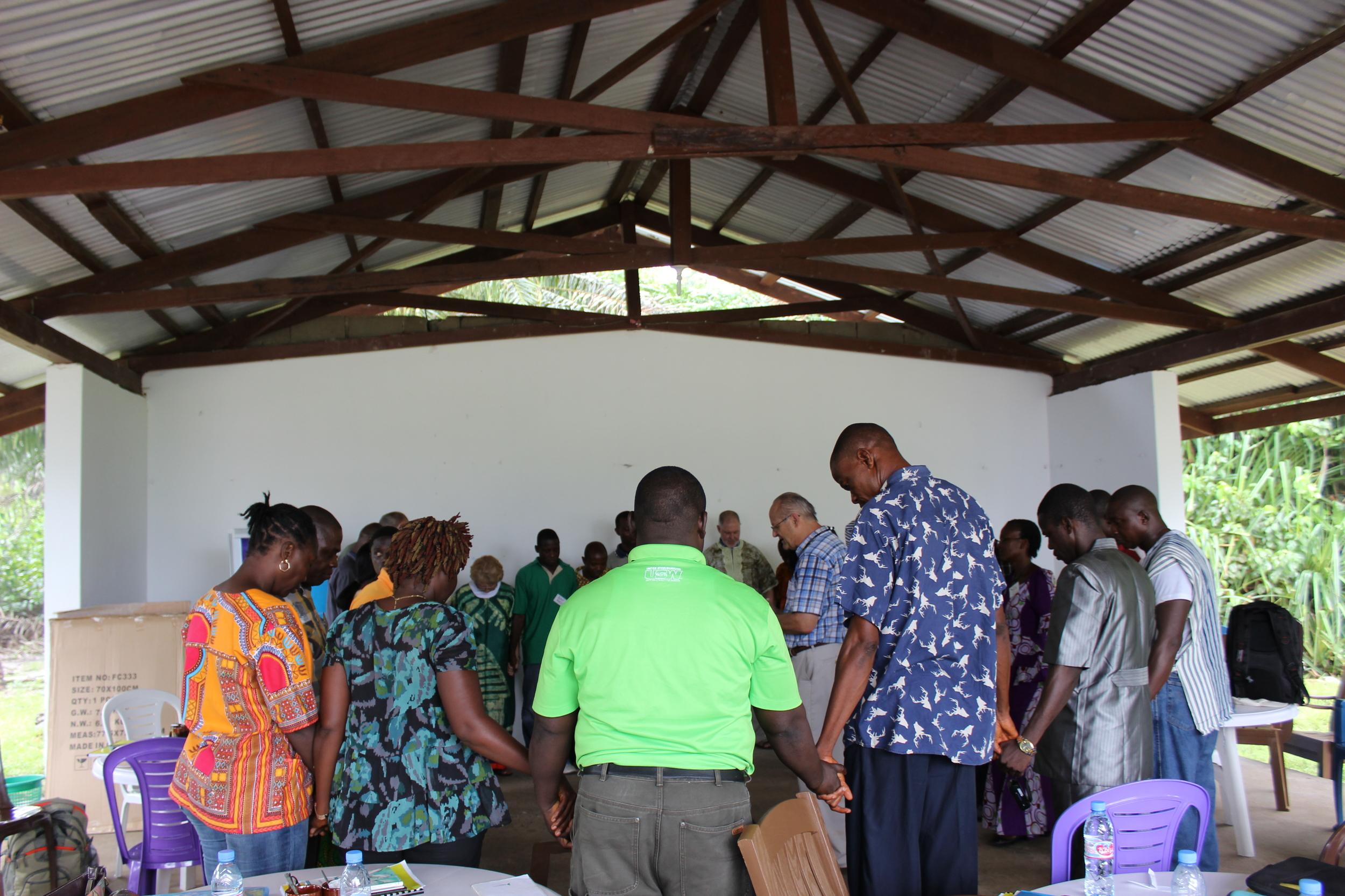 Participants join in prayer during a training session for trauma healing facilitators who will work with Ebola survivors. SIM and ECOL are working together to start groups like this across Monrovia. - Photo by Beth Fankhauser.