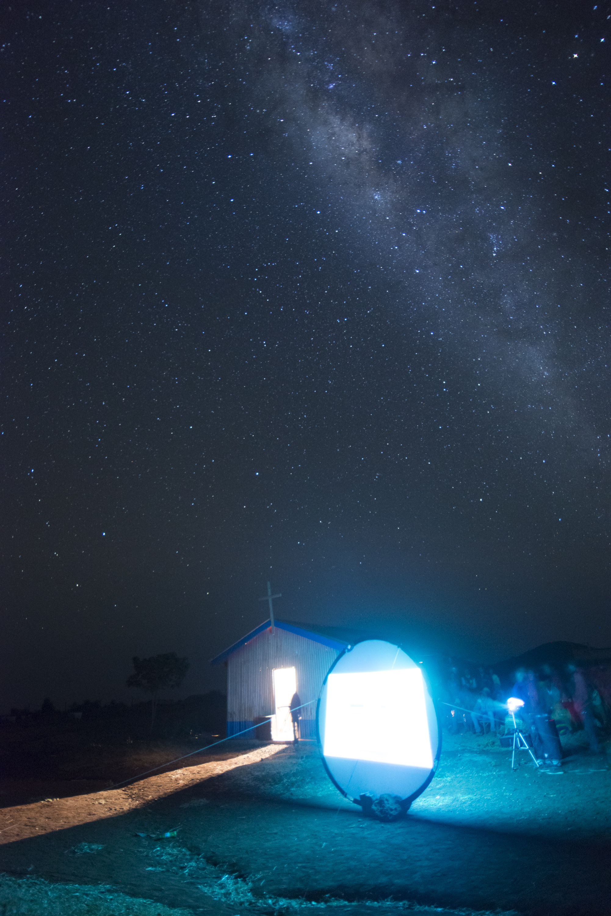 Projecting the Jesus film onto screen under the milky way. The film has been translated to the local dialect and many have come to hear the Bible story and been changed by what they have seen. Photo credit - Tim Coleman