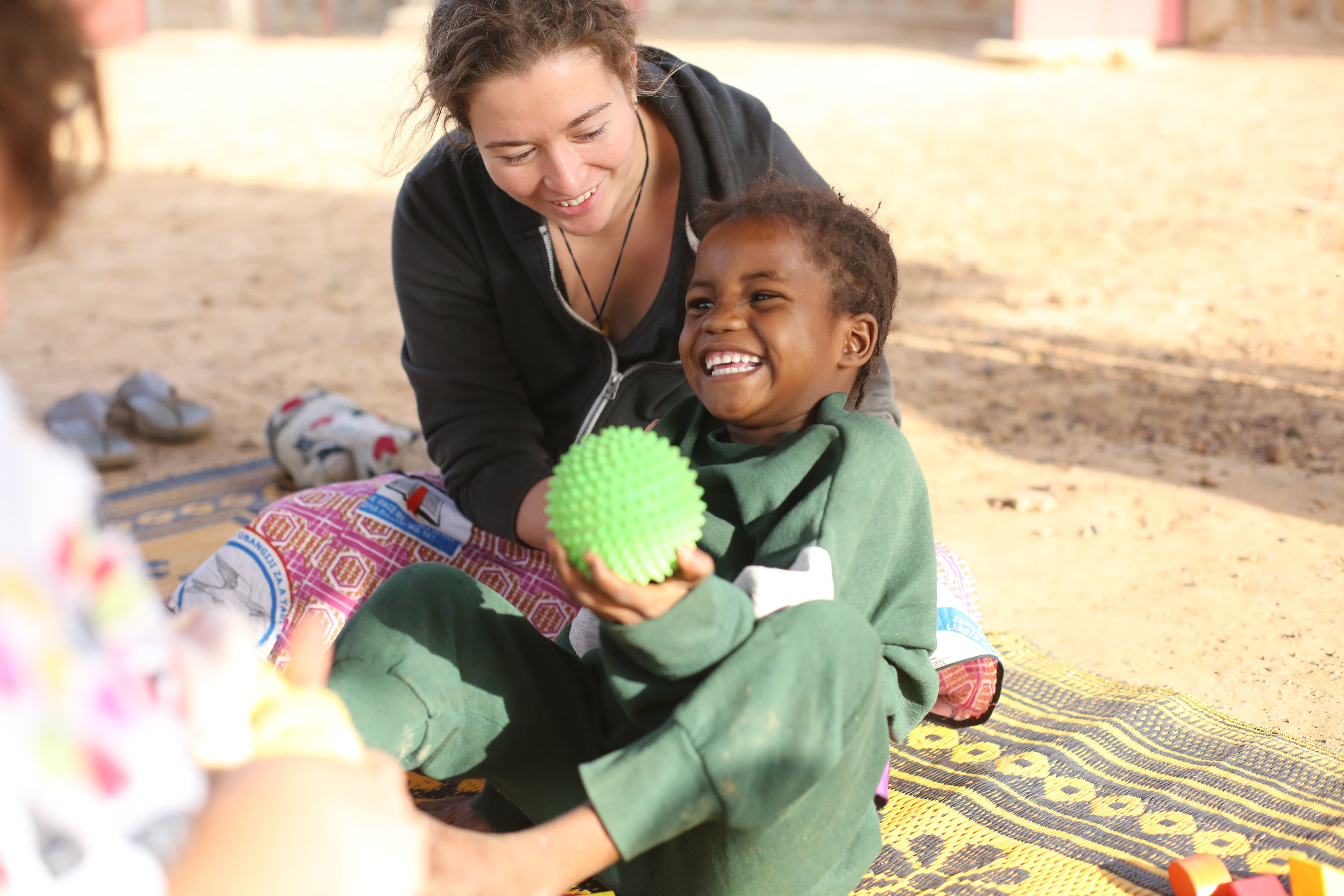 Occupational therapist Amy Griffiths demonstrates an occupational therapy device during the first-ever camp for children with disabilities at Galmi Hospital this past February - Photo courtesy of Deb Knight.