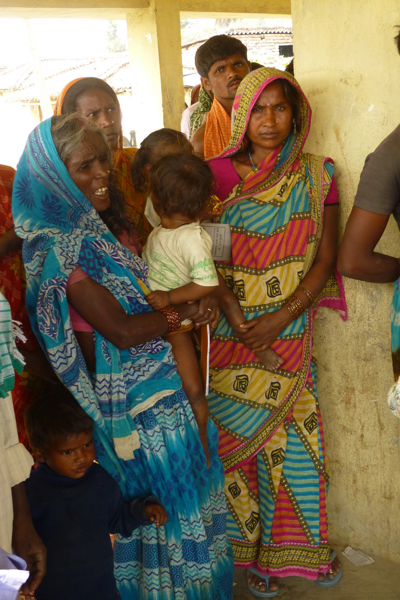 Mothers who a few years ago likely didn't know of the importance of vaccinating their children now wait patiently for their turn to get their children protected - photo by Sarah.