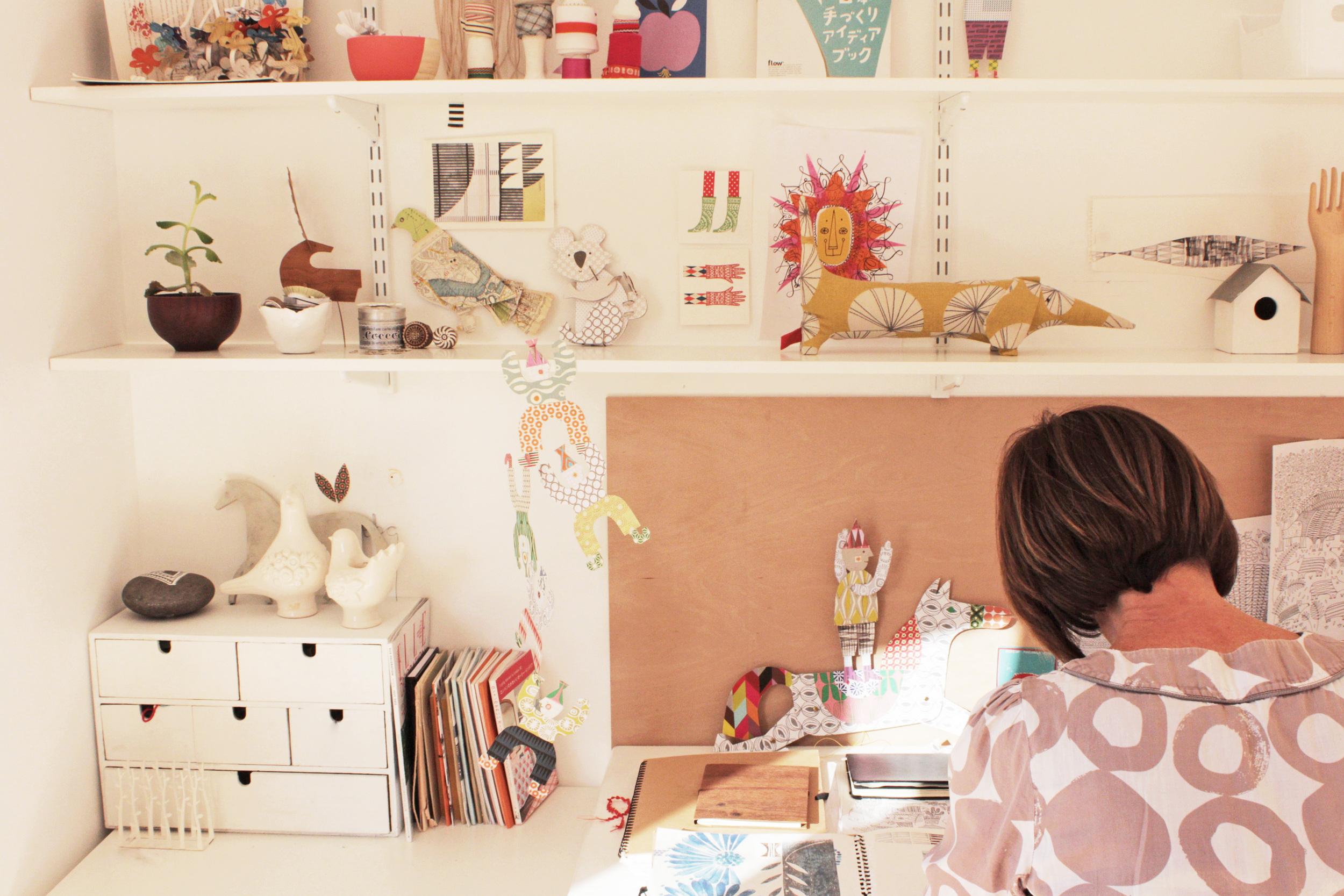 Clare at work in her garden studio