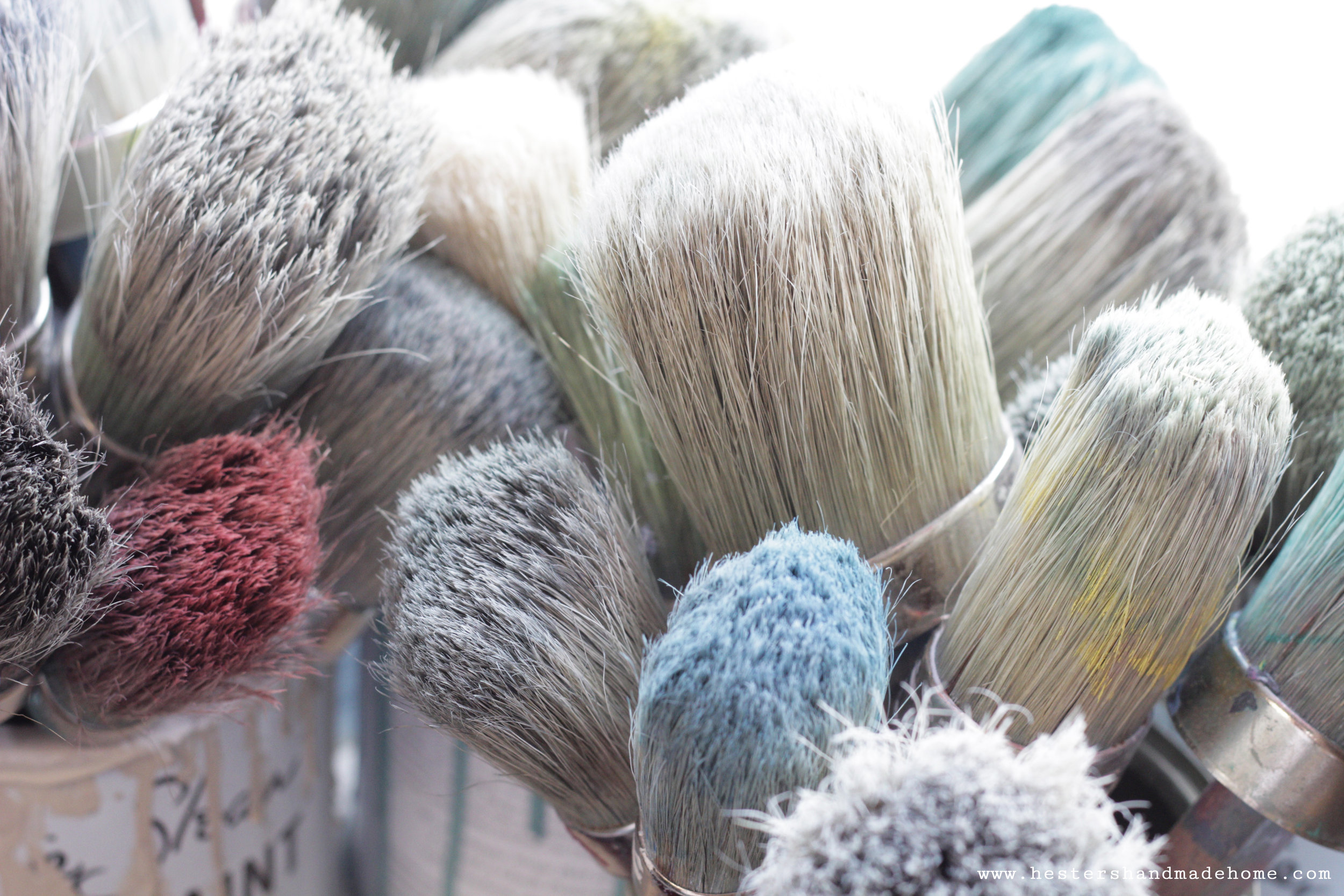 Rows of paint brushes in Annie Sloan's studio. Photo by www.hestershandmadehome.com