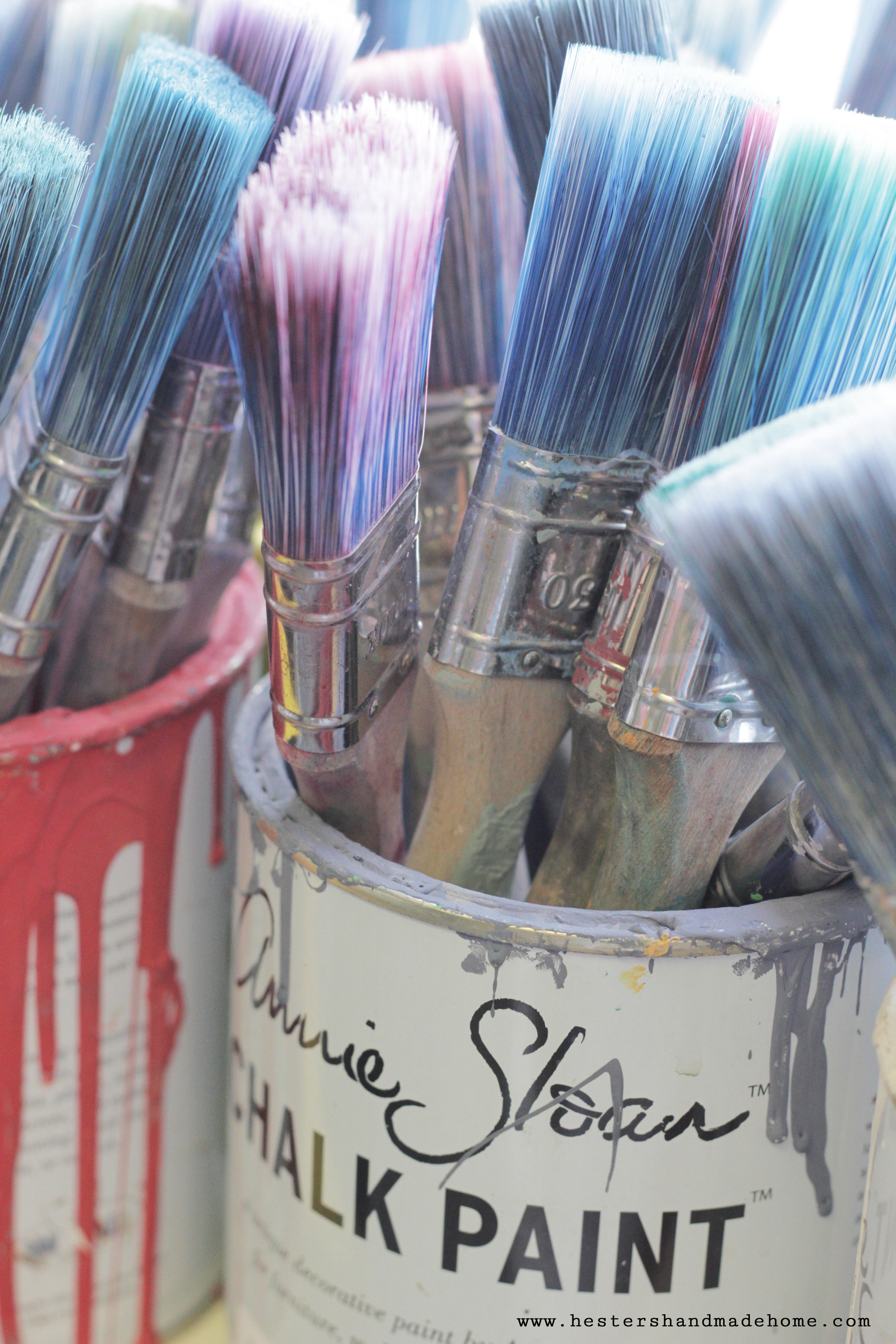 Bucket of brushes in Annie Sloan's studio, photo by www.hestershandmadehome.com