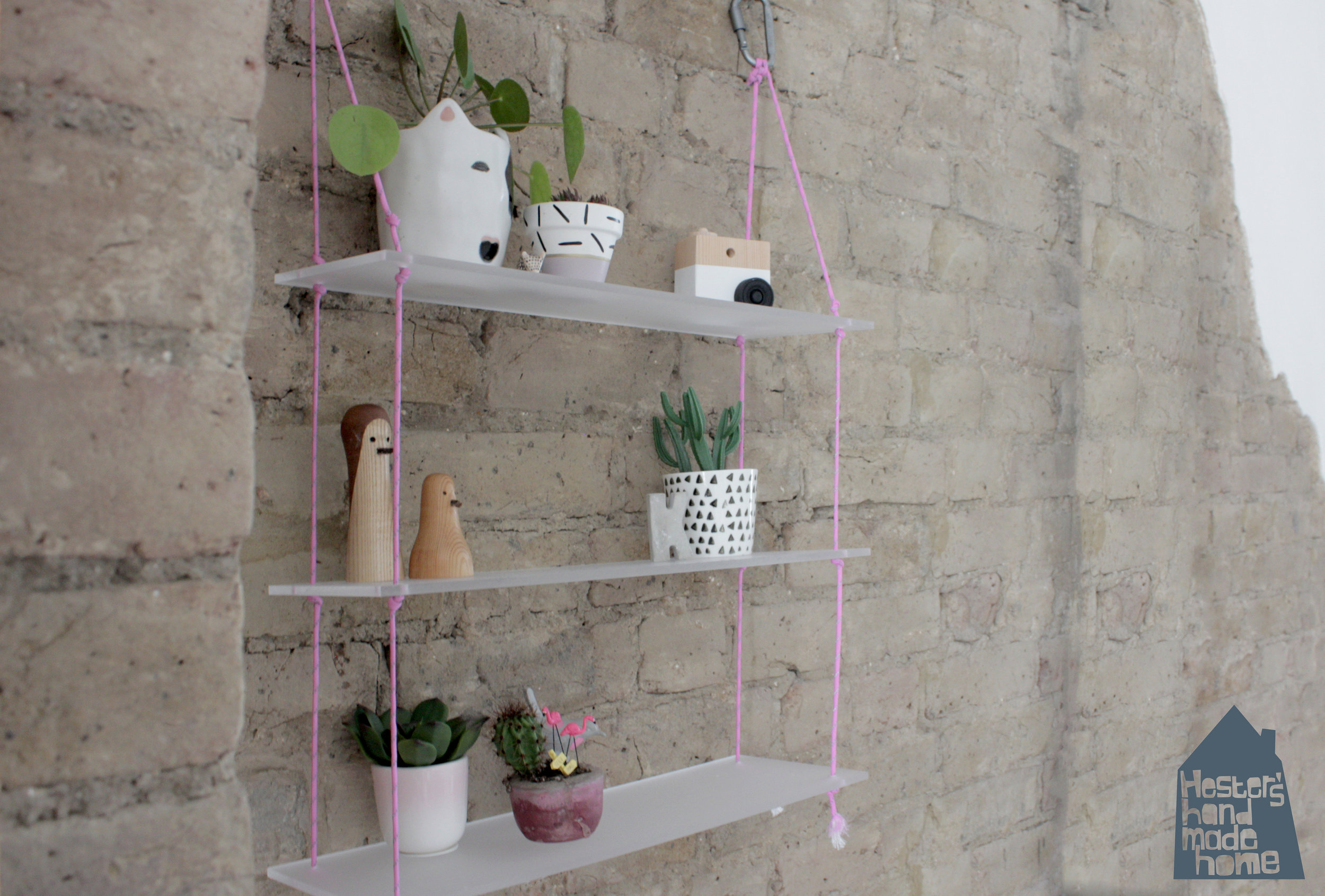 Acrylic shelves with paracord by www.hestershandmadehome.com
