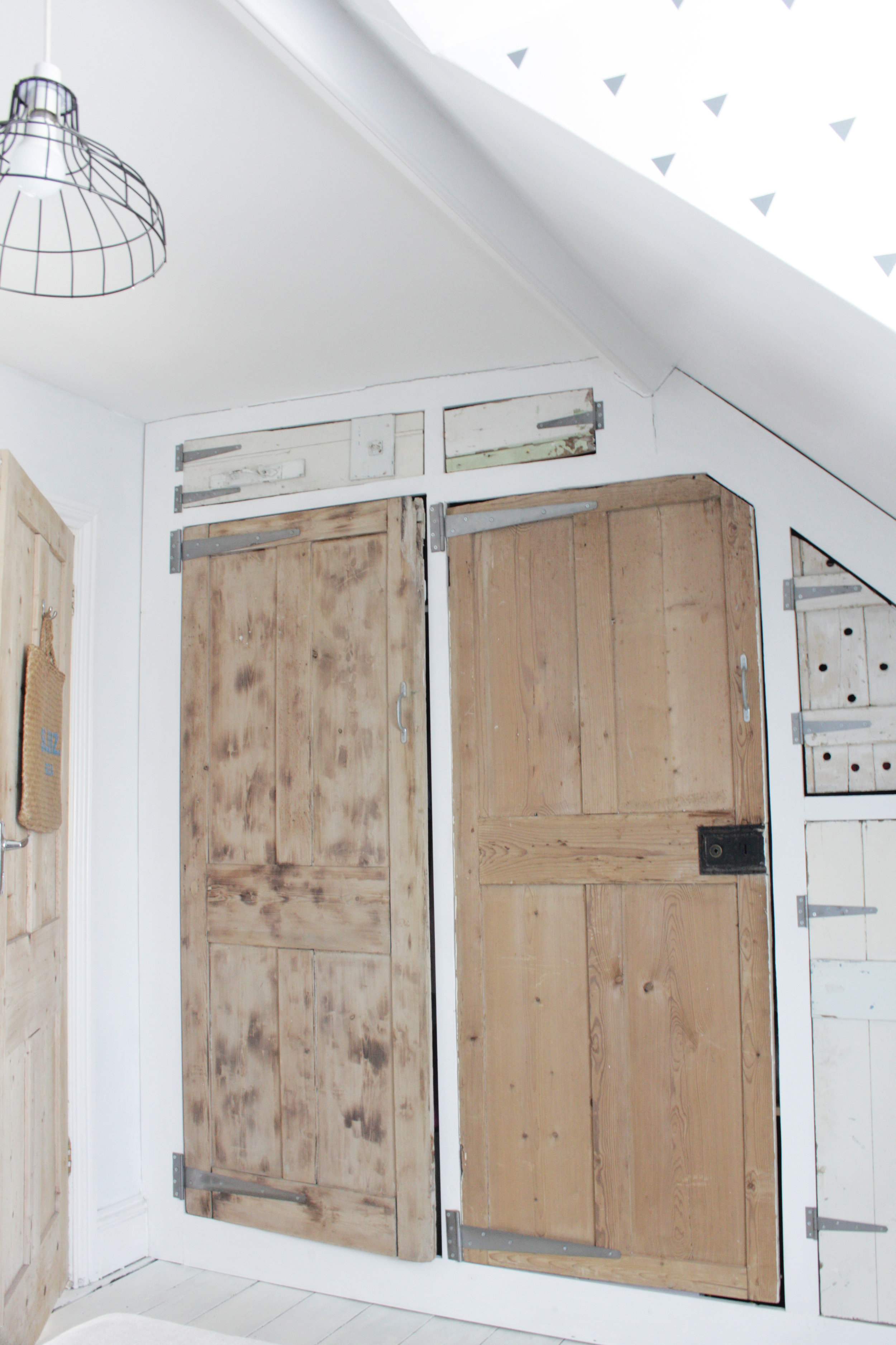 These reclaimed doors hide a lot of clutter