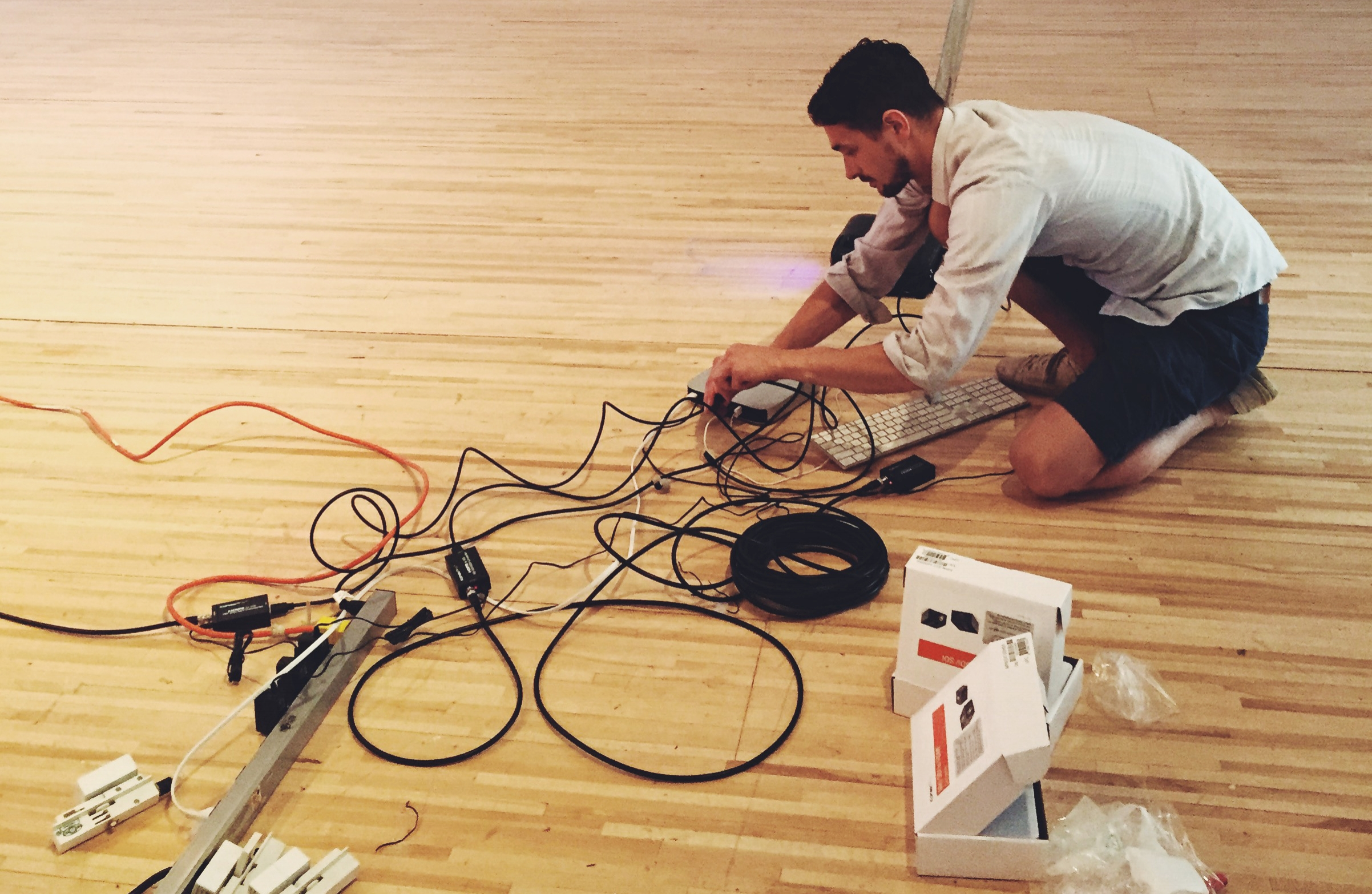 Sasha Phipps , helping to install my thesis exhibition. Or, doing all the wiring as I lay there, ineffective, on the floor. Be better than me.
