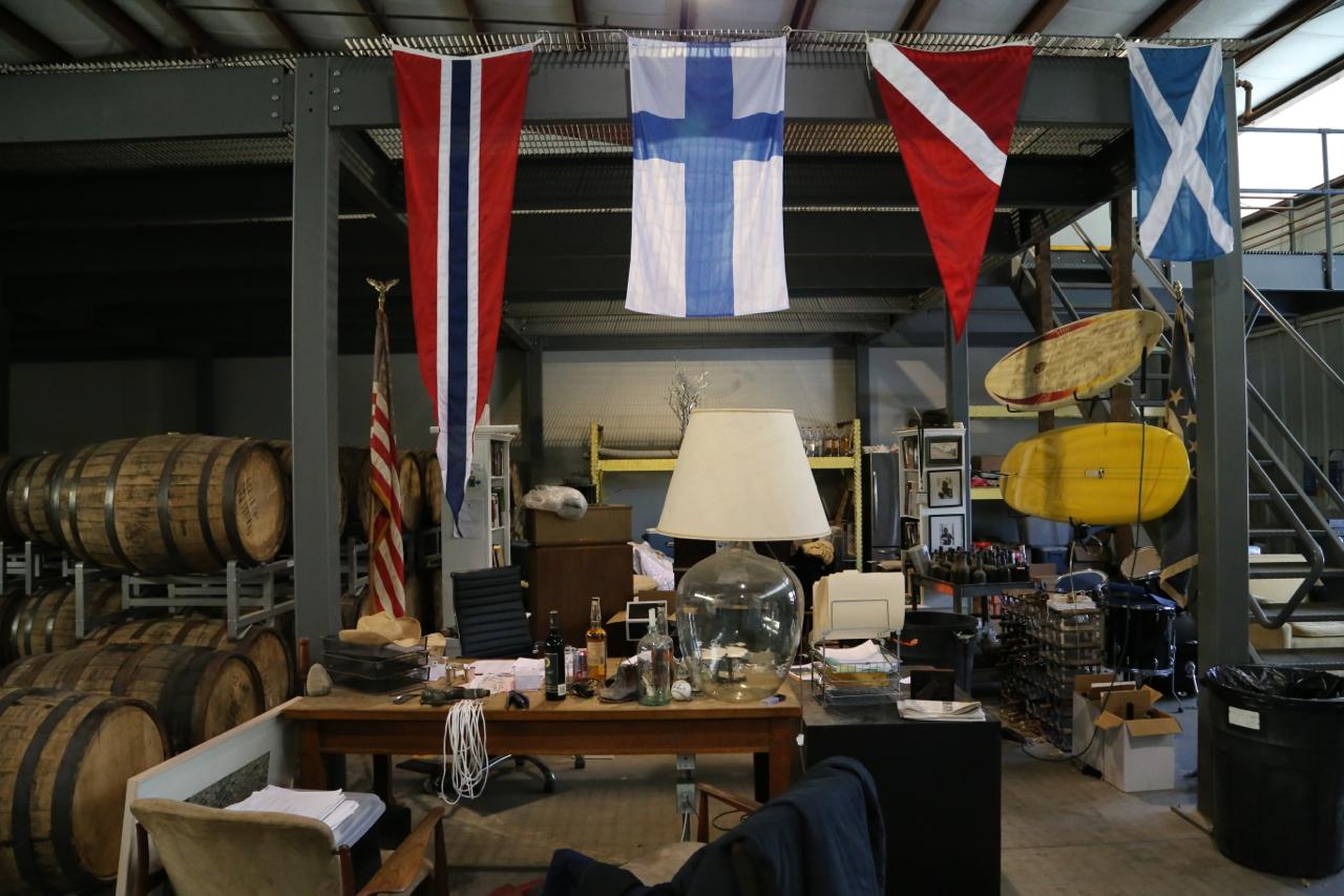 Office essentials: Rum, surfboards, drum kit.