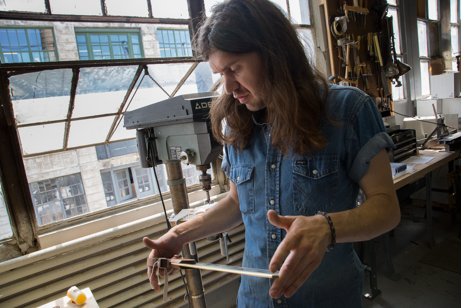 Ben Seltzer inspects a saw.