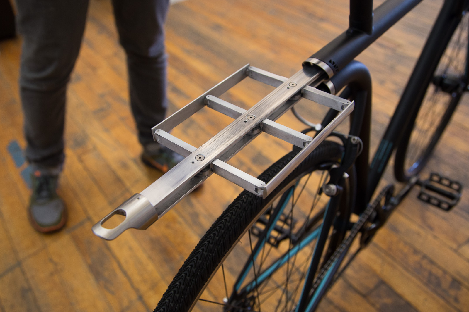 A retractable rack pops back into the bike tube with the push of a button.