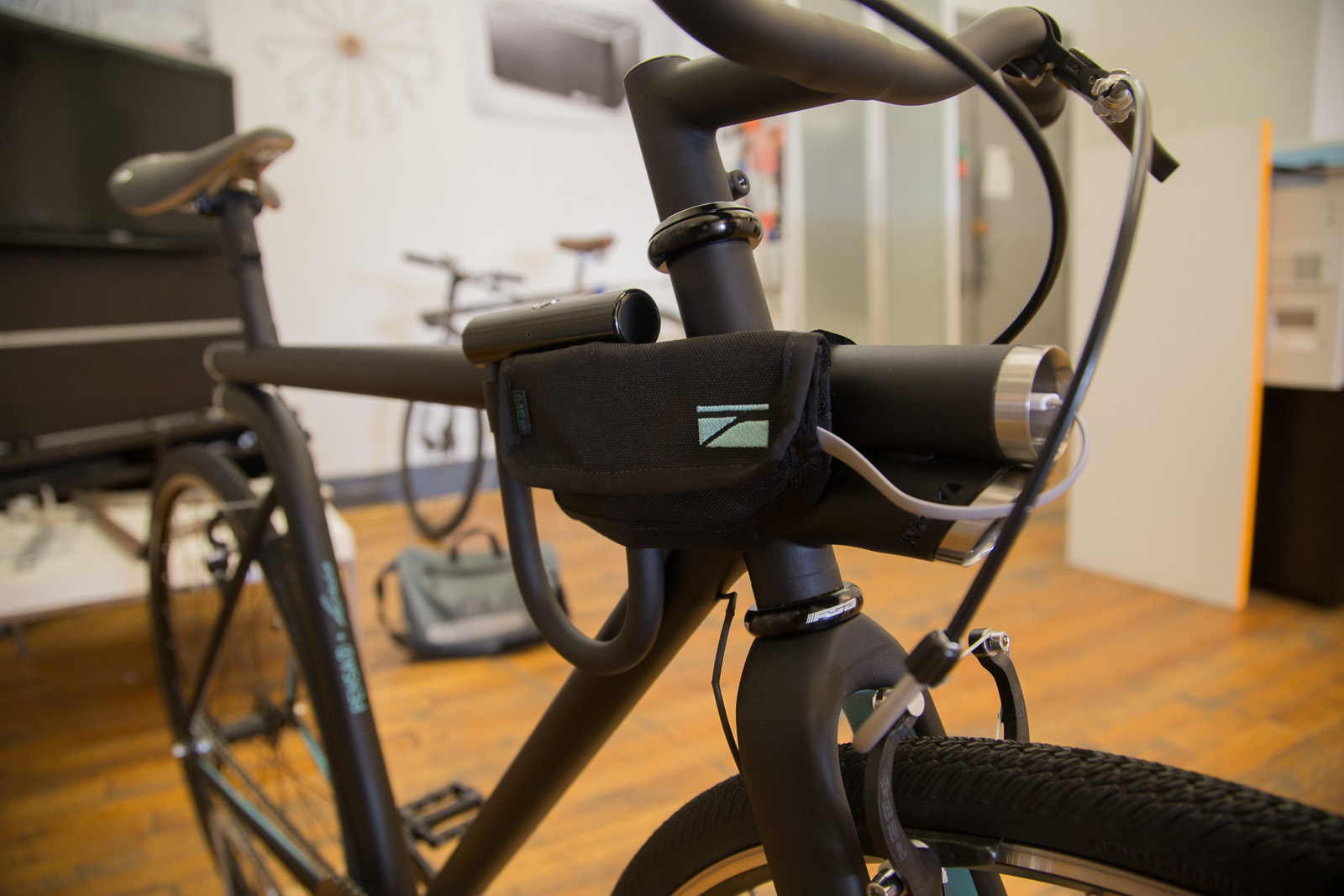 The pouch made by Mer Bags holds a phone that can be charged with a USB cable connected to the bike.